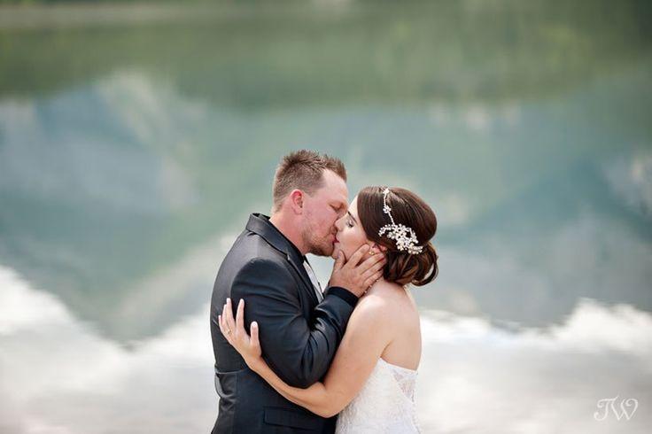First kiss on the shore of Barrier Lake captured by Calgary wedding photographer Tara Whittaker   Kananaskis Country
