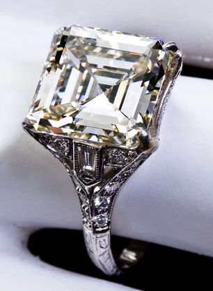 *Art Deco 6.12 Carat Square Emerald Cut Diamond Engagement Ring, A 6.12 carat L color VS1 clarity square emerald-cut diamond center stone set in an Art Deco platinum ring with side bullet-shaped diamonds. Circa 1930.