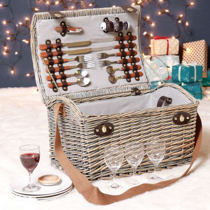 Made from French grey wicker, with a rounded cambered lid, and dark brown leather effect straps and handles to allow for easy transportation. Includes four white ceramic dessert plates, four wine glasses, four sets of stainless steel cutlery, a corkscrew, and two plastic condiment holders. All pieces fit neatly in the hamper and are secured in place with leather effect straps for ease of use. A fantastic wedding, birthday or anniversary gift idea that can be treasured forever! This picnic