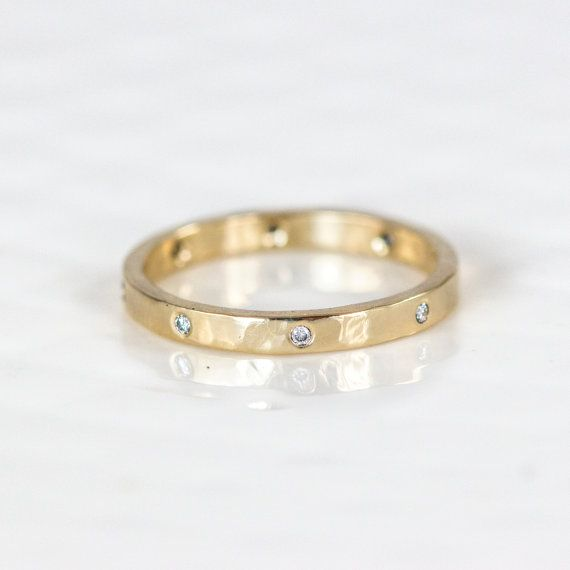 This elegant hammered band holds eight evenly spaced tiny white diamonds. This ring makes a beautiful diamond wedding band, or add it to your