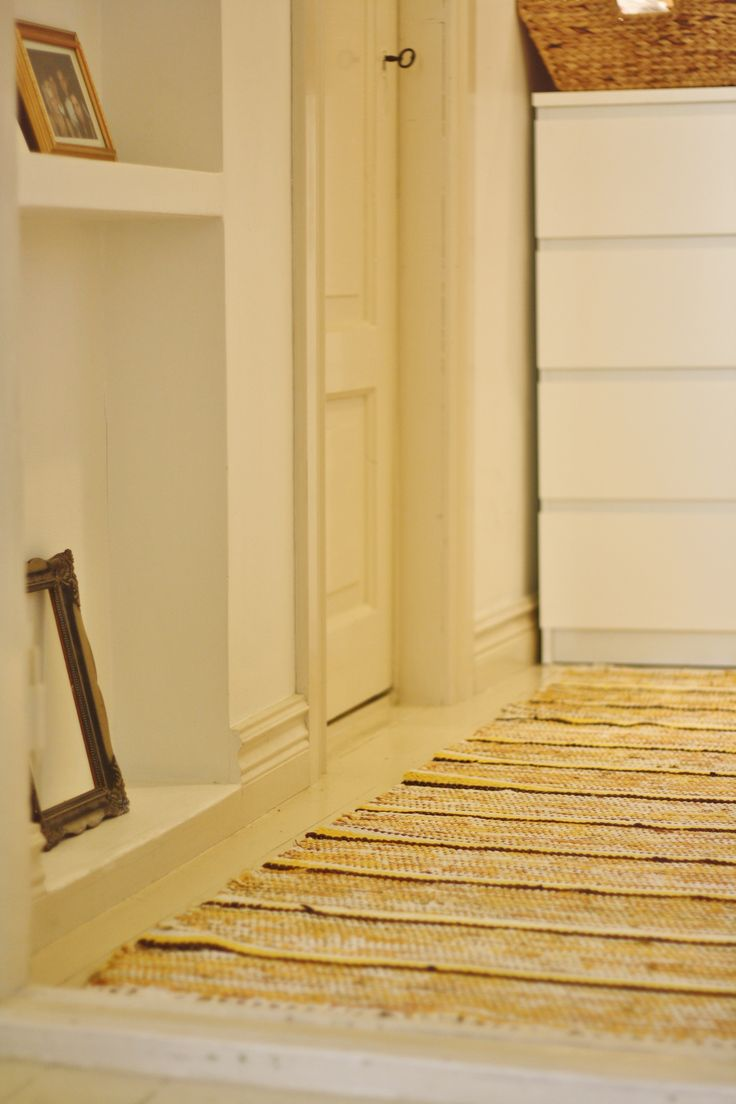Yellow rag rug in the hallway