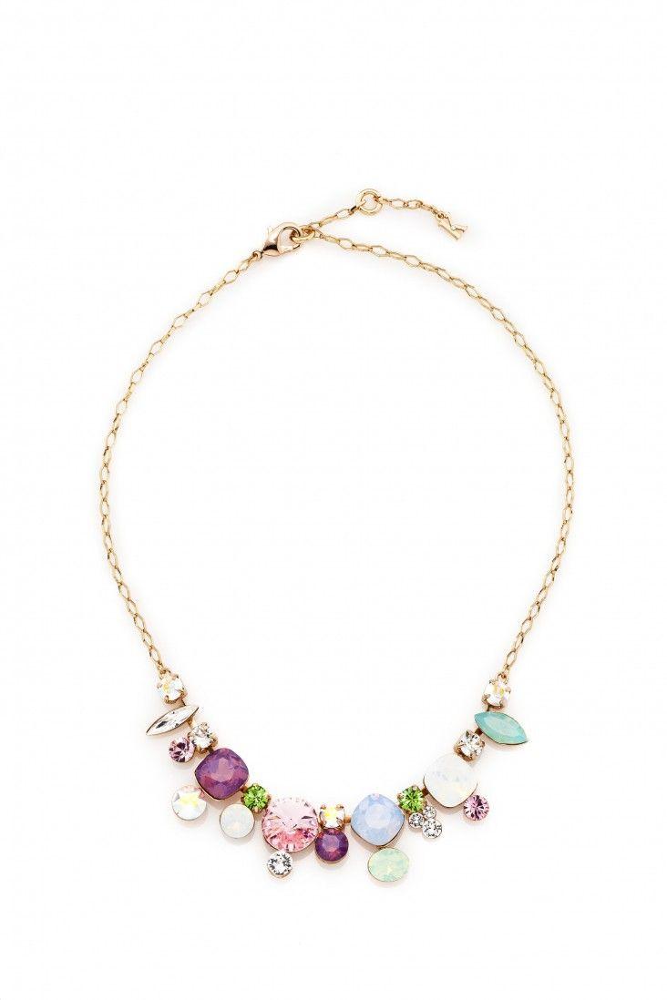 Elegancki naszyjnik pozłacany 24-karatowym złotem i ozdabiany kryształami Swarovski Crystals we współgrających odcieniach bieli, fioletu, błękitu i zieleni.