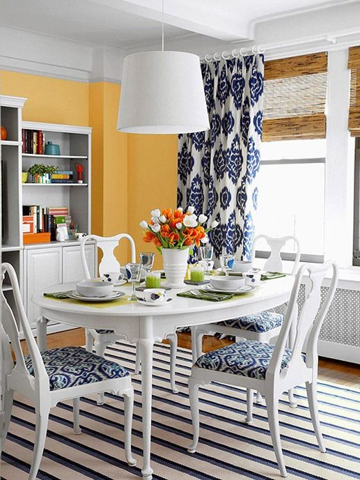 blue and white patterned panels and chair covers