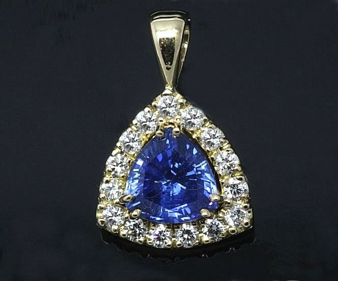 Handmade 18ct. Yellow gold pendant. Featuring a Natural Ceylonese Sapphire and Diamond halo.