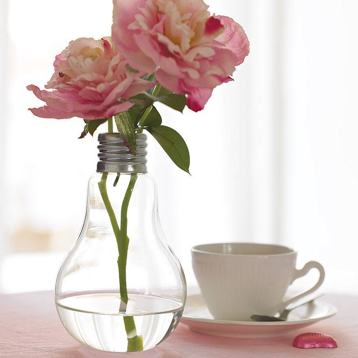 This fun and funky modern lightbulb vase is perfect for the young, modern home.Available as a small, medium or large size standing vase. Also available are the beautiful faux silk flowers as seen in the photographs. The roses are suitable for the large and medium lightbulb vases. The sweetpeas are suitable for the medium lightbulb vase.Looks great anywhere in the home and makes a refreshing change from the traditional vase. Based on the traditional style Edison light bulb, this fun vase…