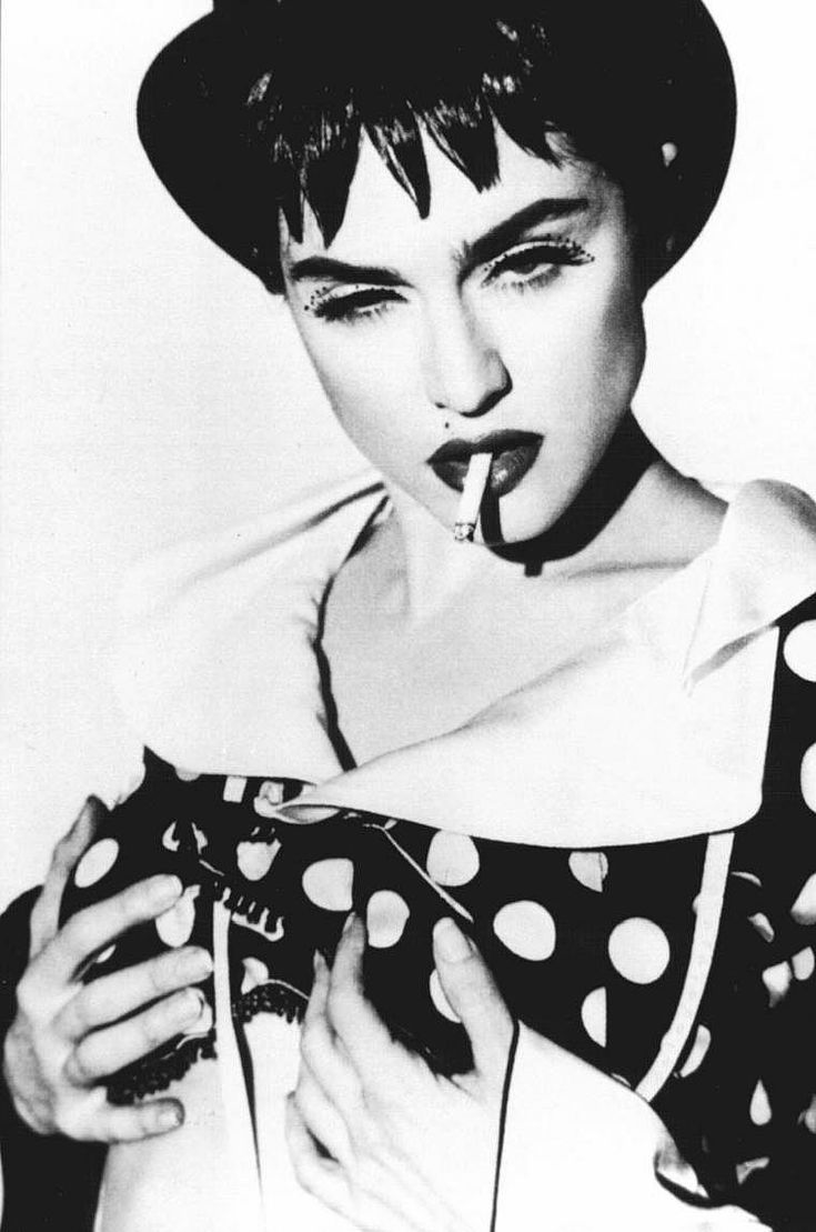 1990 by Herb Ritts (I've always loved her eyelashes in this pic.. but boo on the cigarette)