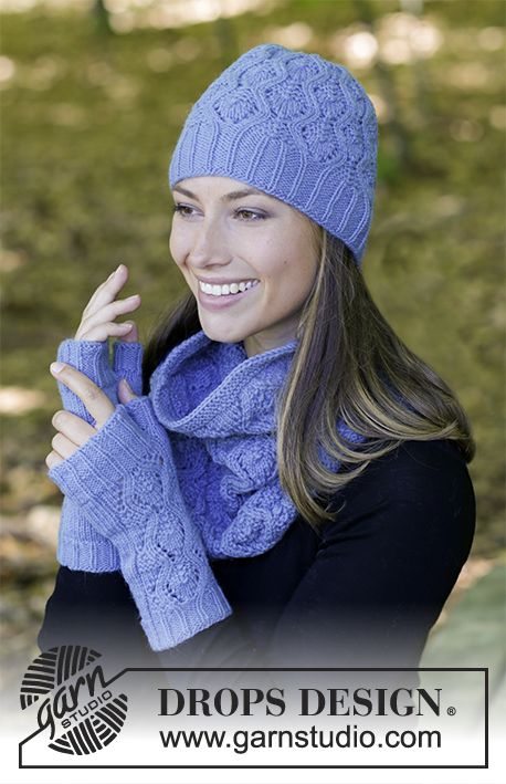 Stay Warm - The set consists of: Knitted hat, neck warmer and wrist warmers with lace pattern. Sizes S/M – M/L. The piece is worked in DROPS Lima. Free knitted pattern DROPS 182-20