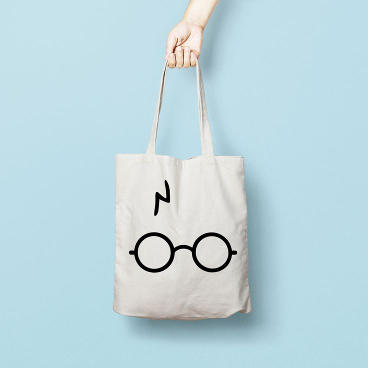 "Harry Potter Tote Bag Canvas Funny Totes Totes are that universal product that everyone needs and uses. A book bag, a grocery bag, or just somewhere to throw in all of those little everyday items. 100% Bull Denim Woven Cotton construction Dimensions: 14 3/8"" x 14"" (36.5cm x 35.6cm) Dual handles Fabric weight 11.0 oz/yd² (373 g/m²) Superior screen printing results A cute, all-purpose natural cotton harry potter tote bag."