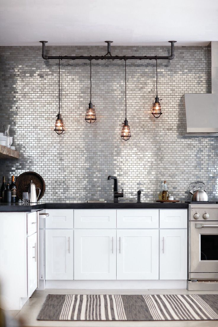 Via designmeetstyle.com...industrial glamour and the lights are the perfect touch...