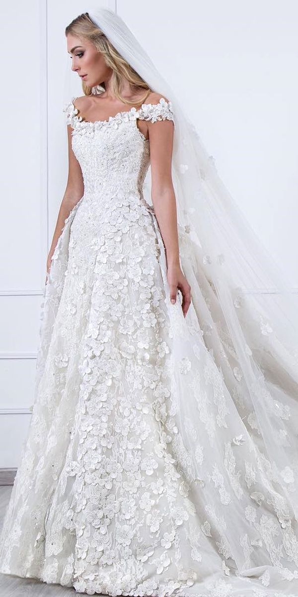 Floral applique wedding dresses are so feminine, elegant and also in trend for this year. Flowers on the dress can decorate all or just a part of gown.