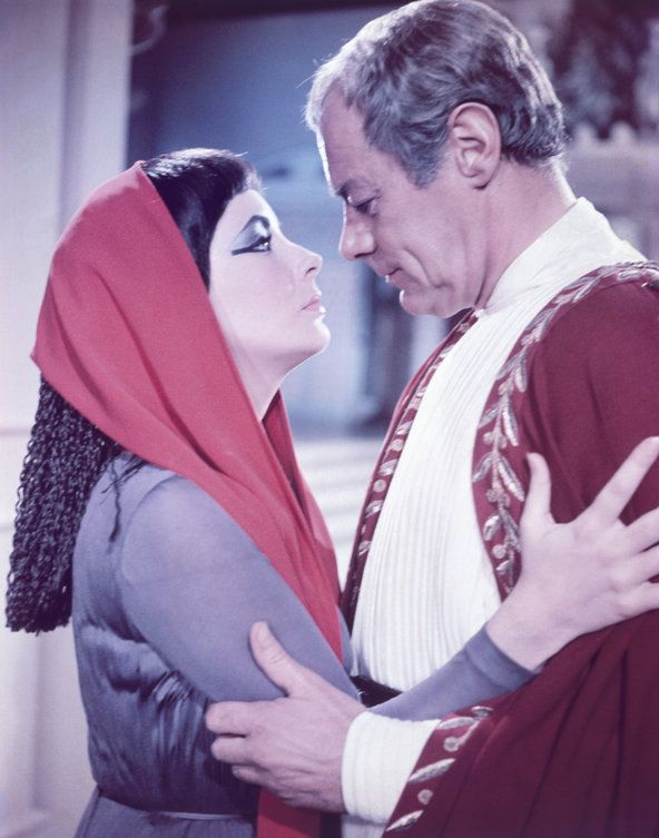 Elizabeth Taylor and Rex Harrison as age-old power couple Cleopatra and Julius Caesar in the movie
