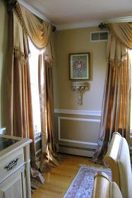 "These window treatments I just installed are quite extravagant! Pole swags and jabots over ruffled panels, all in silk! There is 4"" beaded t..."