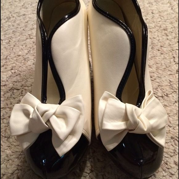 """Classy cream and black heels The super fun and sexy shoes are so classy. New and never worn they have a scuff mark on the back that I am sure I can get out.  They have a 4"""" wooden heel. They are marked size 40 but they fit like a 9. KLD Shoes Heels"""