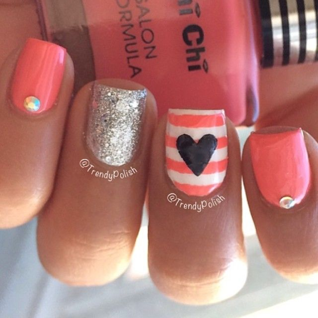 Valentine's Day Nail Art Ideas: Part II - Cute nautical style nail design for Valentine's Day! Pinkish peach nail polish with stripes, a heart, a glitter accent nail with crystal studs.