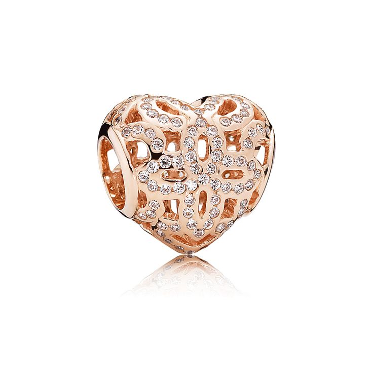 A beautiful representation of love, this romantic pink heart charm with a stylised floral design and glittering stone accents is a sweet way of sharing tender sentiments. #PANDORA #PANDORArose #PANDORAcharm
