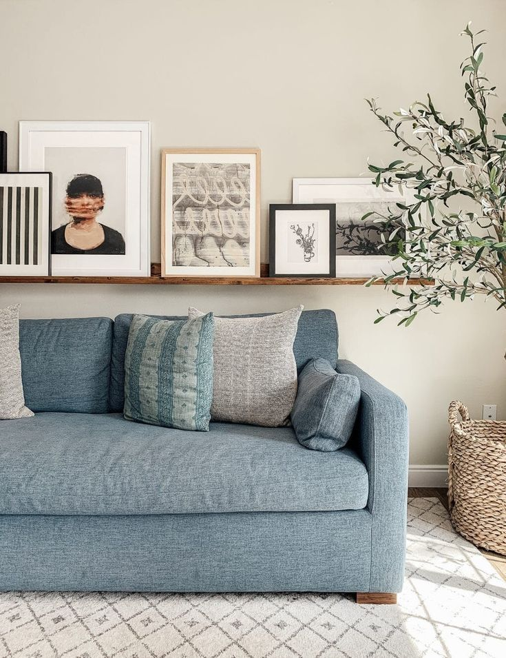 Tips For Creating The Perfect Gallery Wall Light Blue Living Room Blue Sofas Living Room Light Blue Sofa Living Room