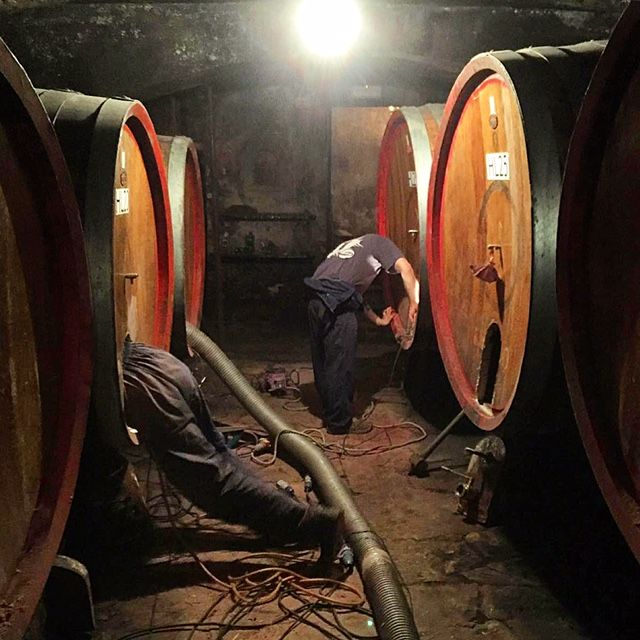 Cleaning out our wood barrels ready for the new harvest