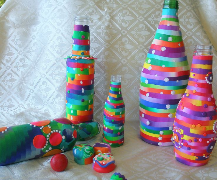 https://flic.kr/p/afmnaS   A summer of dots and stripes   The recycled  bottles  I made during vacation time. The big is a mineral water bottle, the rest are ouzo little glass bottles.