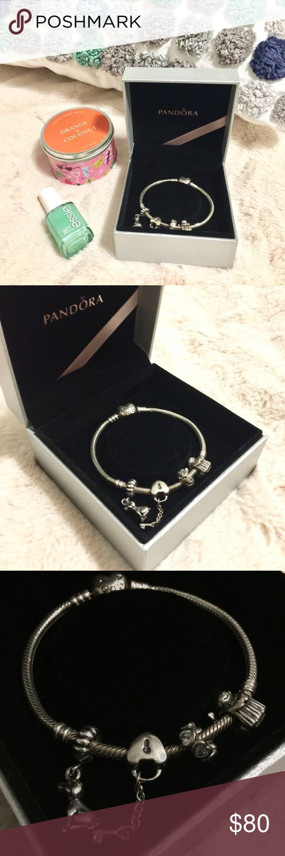 """Pandora Charm Bracelet This is my *authentic Pandora charm bracelet with the heart clasp. It comes with four charms: the dog, heart locket and key, jeweled heart band, and the guardian angel! I believe it is the 6.7"""" bracelet, but will double check on that. :) Pandora Jewelry Bracelets"""