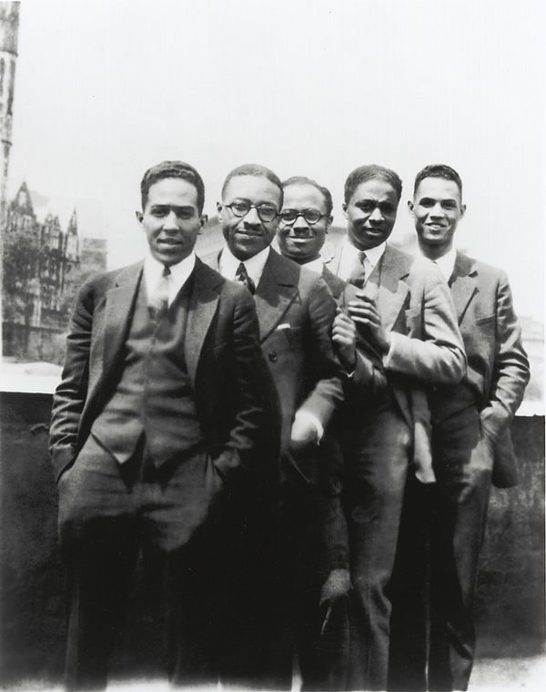 Langston Hughes, Charles S. Johnson, E. Franklin Frazier, Rudolph Fisher and Hubert Delany (brother of the Delaney Sisters) overlooking St. Nicholas Avenue in Harlem in the 1920s. Photo via the Schomburg Center.