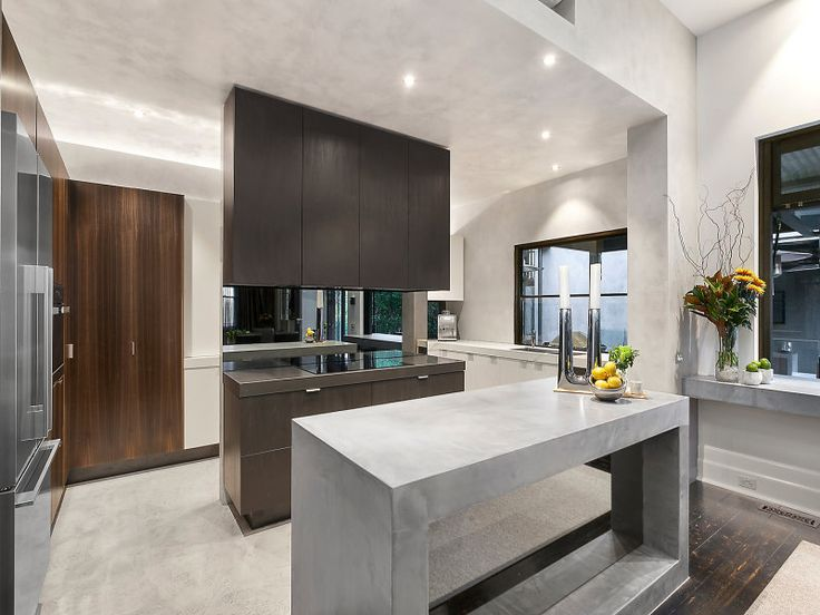 Modern kitchen design with SEMCO concrete countertop, seamless floors and walls to complete the modern design.
