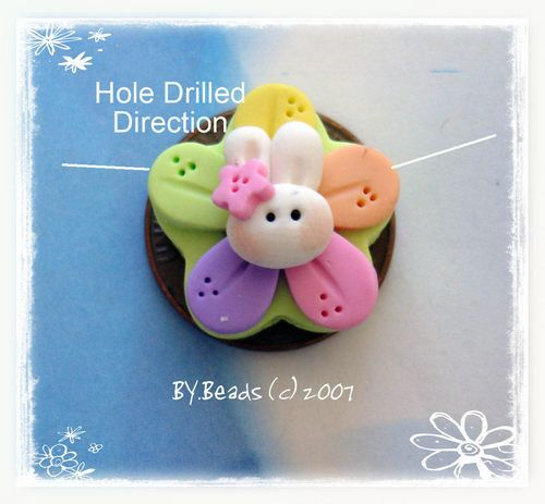 Easter Bunny Blossom Flower Polymer Clay Charm Bead Scrapbooking Embelishment Bow Center Pendant Cupcake Topper. $2.25, via Etsy.