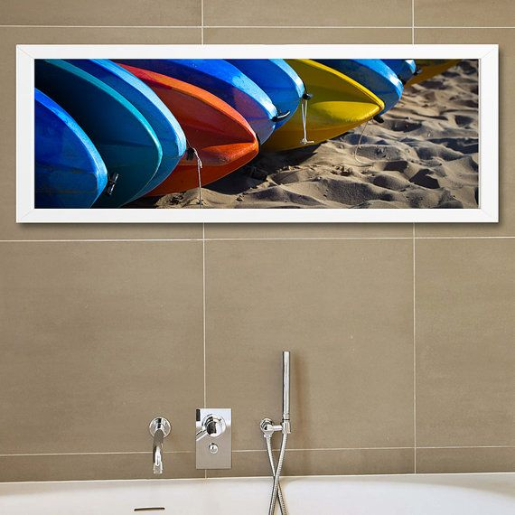 Interior design idea with a large fine art beach photography with blue red and yellow surfboard, perfect to decorate a bathroom wall, it is