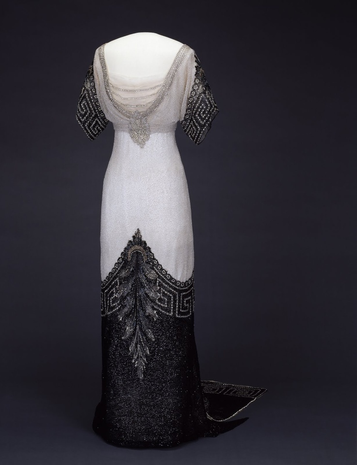 """Evening Gown """"Arlesienne"""" - Winter Collection 1912-1913. 1912 - Worth (Paris / London) - Silk covered with tulle, embroidered with white pearls, silver and black"""