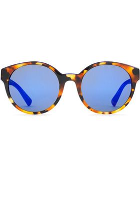 A custom shade of blue presents a striking contrast to the cheetah print of these Etnia Barcelona sunglasses. Part of the brand's Wild Love in Africa collection, the Africa 01 model features vintage-inspired, softly mirrored circular lenses. Unisex. #ecofashion