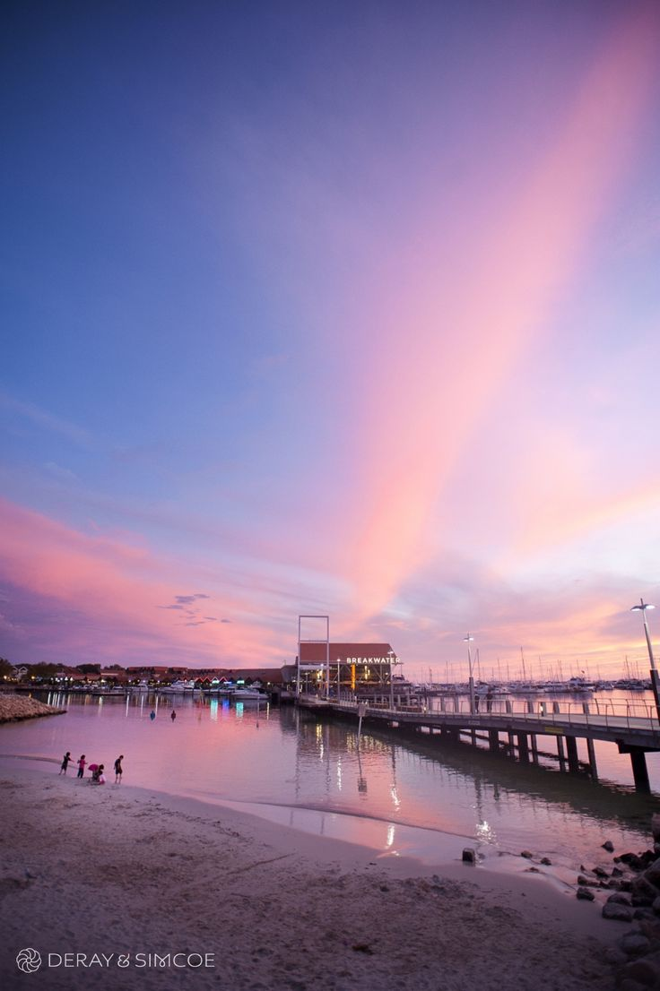 Sunset over the ocean at Hillarys Boat Harbour.  Photography by DeRay & Simcoe