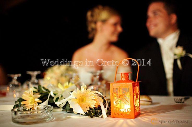 Weddings in Crete - Flower Arrangement and Small Orange Lanterns