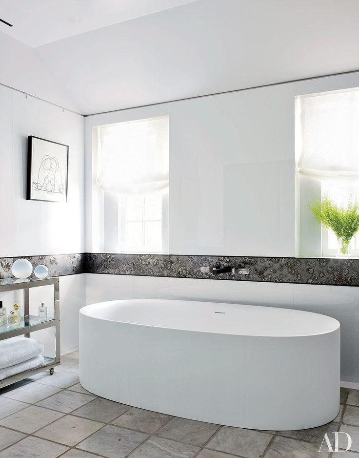 In collaboration with Alveary Architecture, Joe Nahem of the design firm Fox-Nahem Assoc. updated the Greenwich, Connecticut, residence of Allison Kanders and her husband, Warren. A Boffi tub anchors Allison's bath.