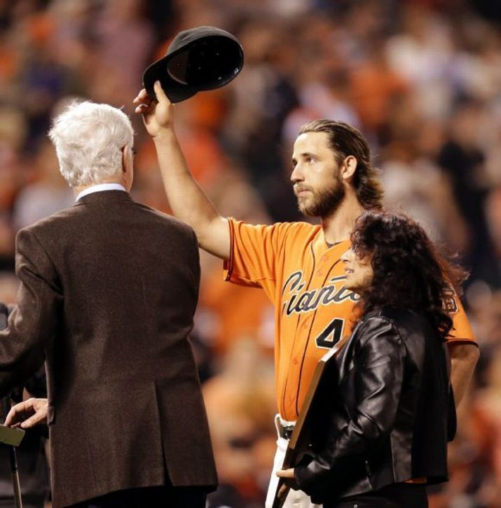 San Francisco Giants' Madison Bumgarner tips his hat to fans after being named the 2014 recipient of the Willie Mac Award prior to a baseball game against the San Diego Padres, Friday, Sept. 26, 2014, in San Francisco. At right is Allison McCovey, at left, Giants announcer Mike Krukow. (AP Photo/Ben Margot)San Francisco Giants Team Photos - ESPN