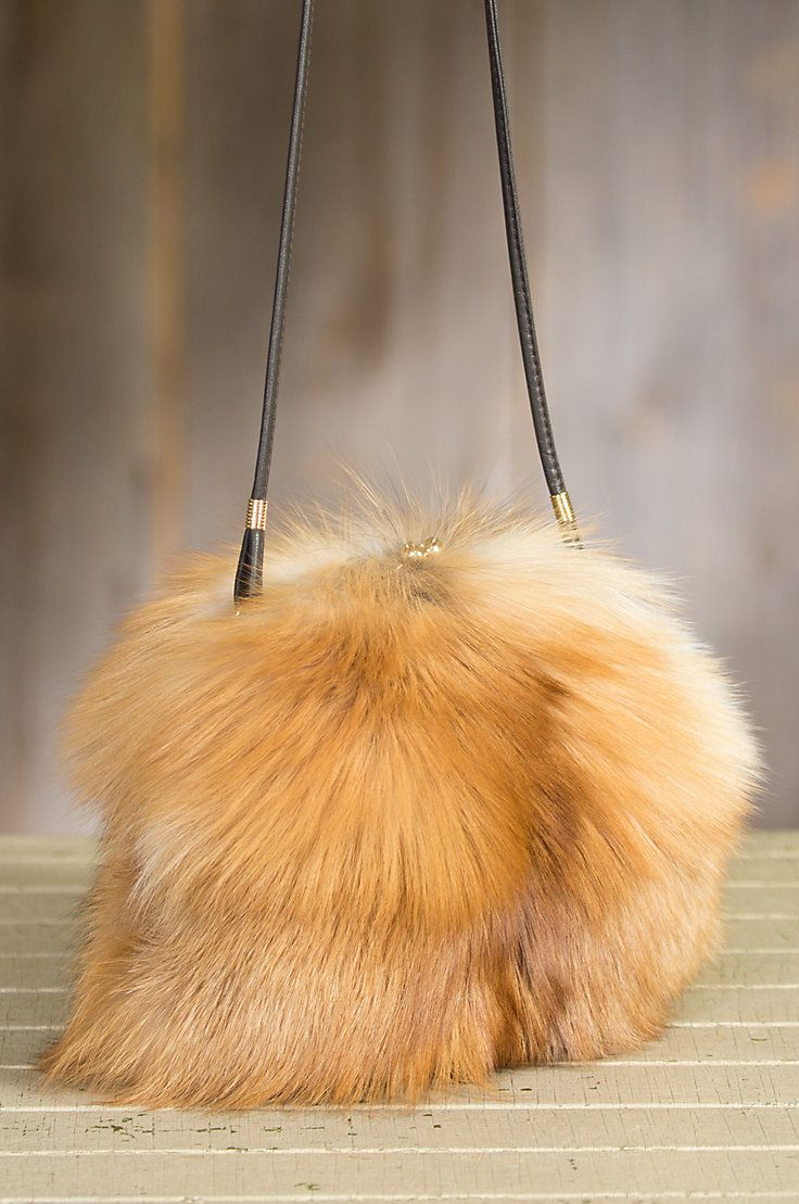 Our Red Fox Fur Muff Handbag is a hand warmer muff with a built-in purse which makes it a great conversation piece as well as an amazing gift.