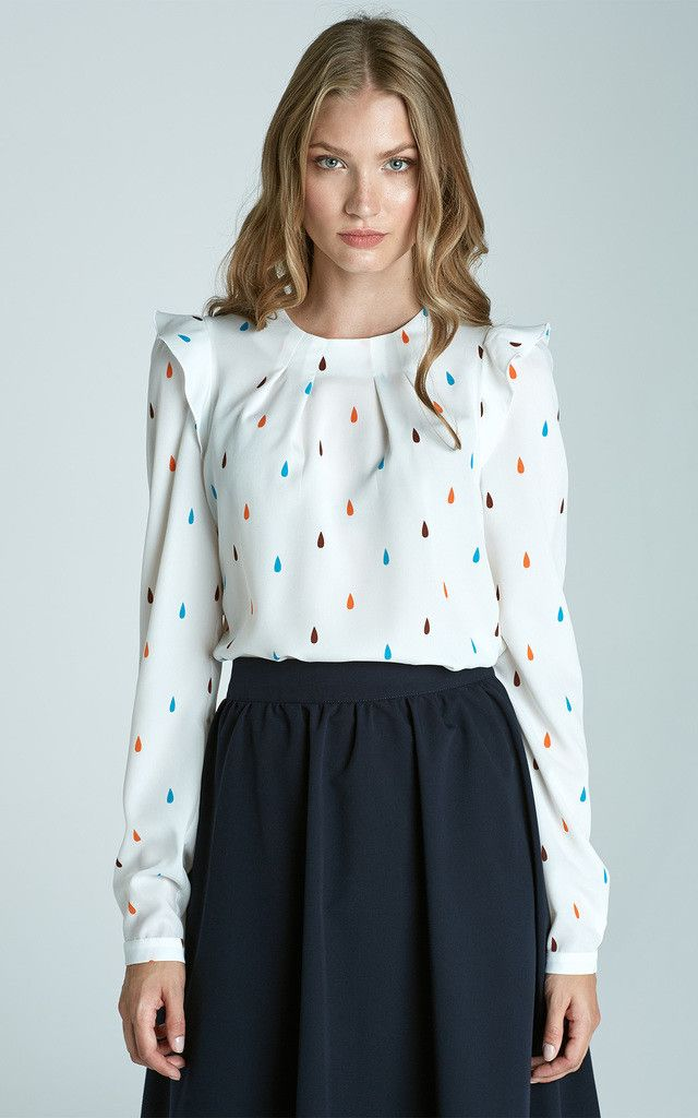 Long sleeve white blouse with tear drop pattern and frill shoulders. Perfect for office or work wear. Shop Now.