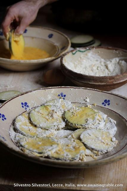 Preparing la parmigiana... by silvestrosilvestori, via Flickr - hehas fab Italian food photos