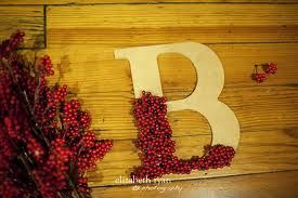 christmas craft - glue red berries on wooden letter... could also add a few pine sprigs for the red and green effect