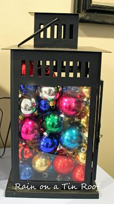 Thrifty Christmas Decorations - pictured here thrift store ornaments in as lantern. Check thrift stores before Christmas as they usually put out their Christmas items then (some will sell some new/discounted Christmas items too.)
