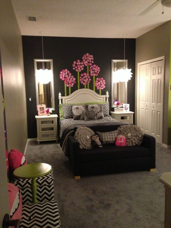 Girls room age 10 & up, room to grow, Grey tones with white & splash of hot pink & lime green. Modern, clean line approach with use of girly white & mirror furniture; white Ikea desk and cabinets. Placing couch in front of bed creates more space, pulls out for sleepovers. Extra large craft table / desk made of 2 Ikea cubbies & tabletop. Makes great use of space to store supplies underneath. Organization to the fullest.