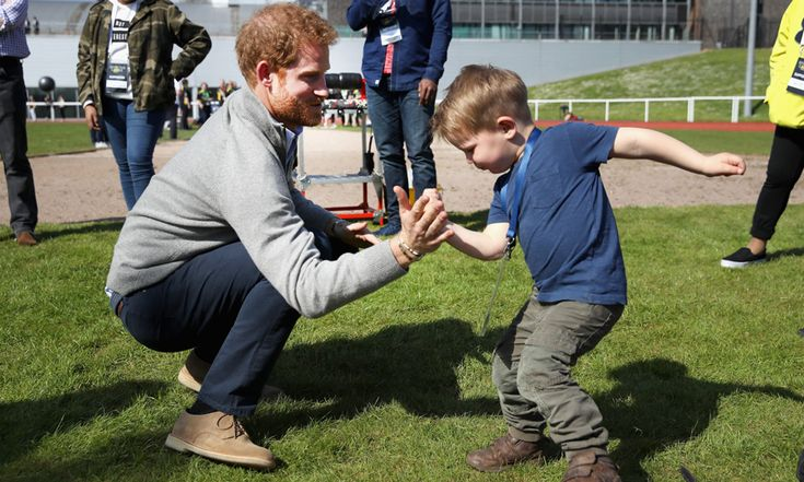 """The British royal horsed around with one participant's son named Harry Phillips. The two-year-old joked around with Harry taking part in a mini boxing match. When asked who had won, the tot proudly said """"Me!"""" His father Dan added, """"Big Harry was teaching little Harry to box. They were high-fiving and boxing. We were chuffed to bits that they met as we call our son our Prince Harry!"""""""