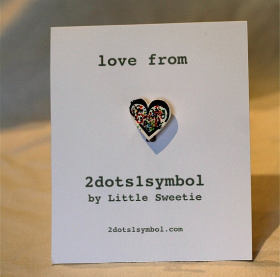 """Little Sweetie (my daughter) has launched a line of emoticon-based jewelry: """"Googlelover's rainbow emoticon heart brooch by 2dots1symbol, $10.00"""""""