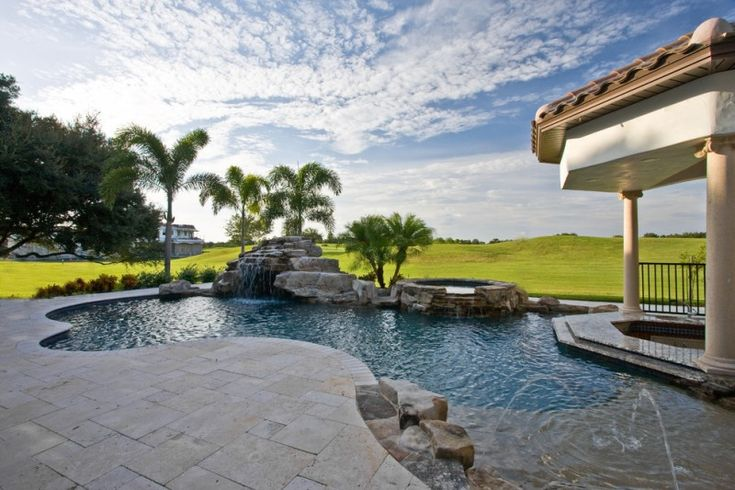 travertine pavers pool deck pillars jacuzzi fountains steel fence trees decorative plants mediterranean design of Elegantly Beautiful Travertine Pavers Pool Deck to Feast Your Eyes On