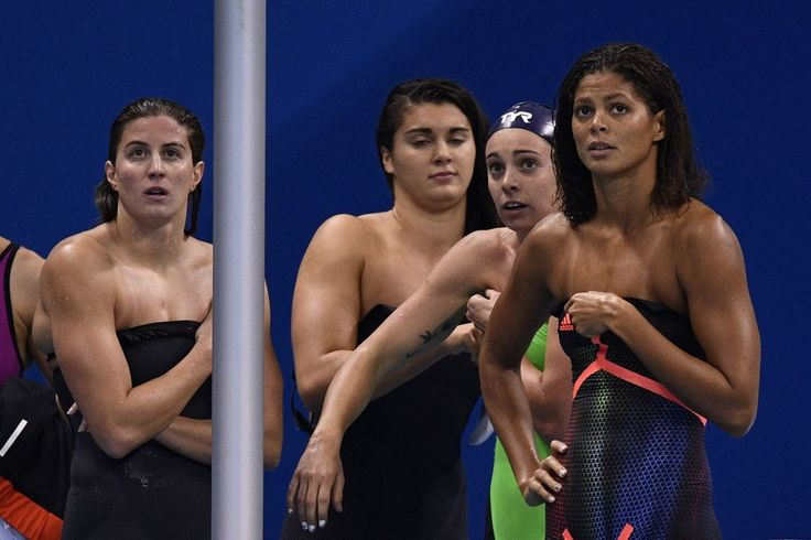 (From L) France's Charlotte Bonnet, Cloe Hache, Margaux Fabre and France's Coralie Balmy look dejected after competing in the Women's 4x200m Freestyle Relay heats during the swimming event at the Rio 2016 Olympic Games at the Olympic Aquatics Stadium in Rio de Janeiro on August 10, 2016.   / AFP / Martin BUREAU