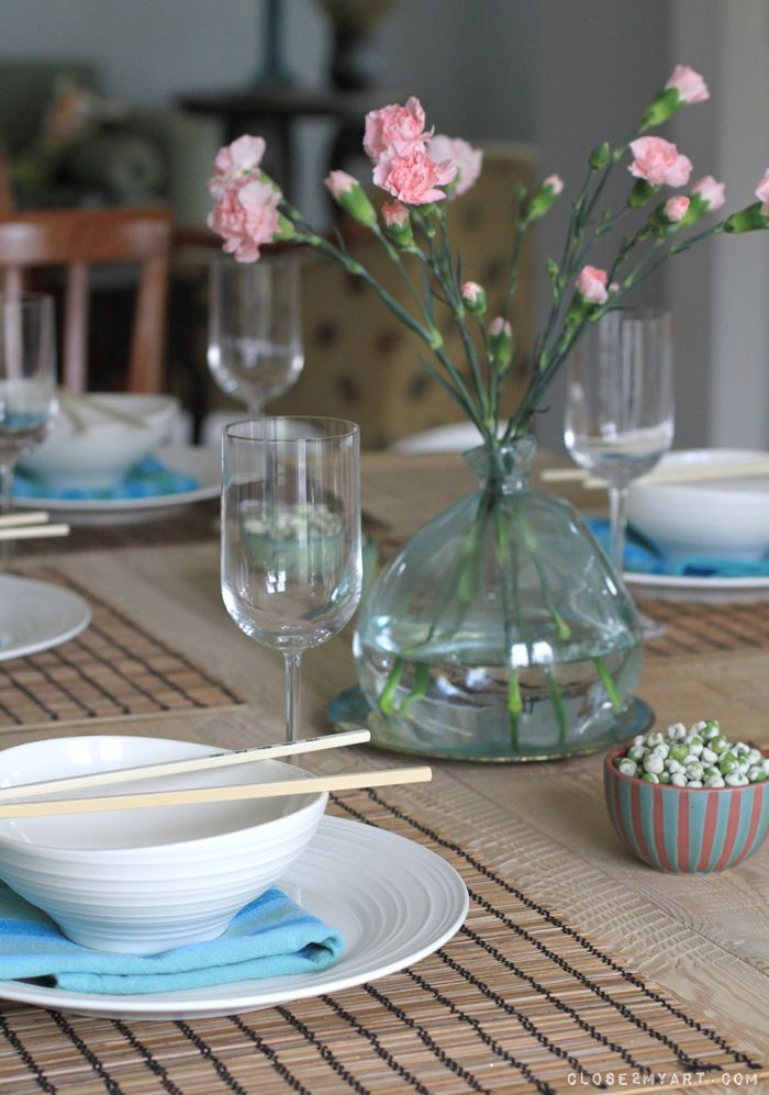 Asian Theme place setting - chopsticks on bowls, simple and minimal flowers