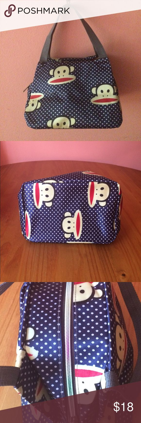 """🆕 Lunch tote Monkeys and polkadots. Blue lunch bag with white polkadots, grey / gray handles, grey / gray interior, and multiple monkey faces. Rainbow zipper. No interior pockets. Approximately 11"""" H x 10"""" L. Measurement includes straps. Please ask if you have questions. Paul Frank Bags"""