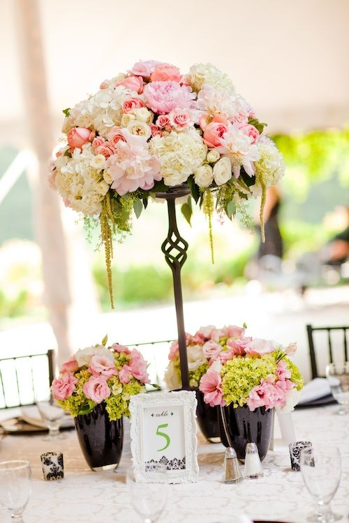 Beautiful blooms wrought iron stand with pink white