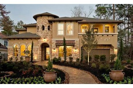 Three lighted arches to the left and right flank a stone turret that serves as the entry. New homes in The Teravista: Kingston Collection by Village Builders. Round Rock, TX.