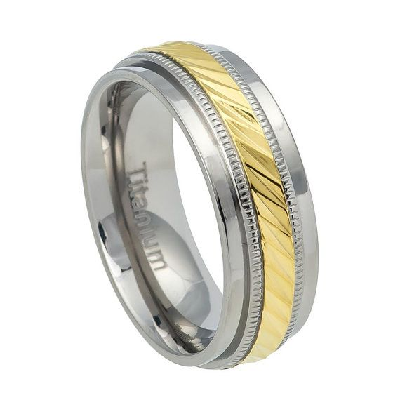 7.5mm Titanium Wedding Band with Hammered Center and Yellow IP Milgrain , SKU# Ti555EL    TO BUY: Shop directly at spreesy.com/elmanjewelry/55    Sizes: 6-12    Style: Fashion, Modern  Type: Titanium Wedding Ring  Material: Titanium, Plated Gold  Color: Grey + Gold  Ring Width: 7.5mm  Package Includes:  1 x Ring (Without Gift Boxes)    Notice:  1.Due to the difference between different monitors, the picture may not reflect the actual color of the item. Please consider this before placing an…