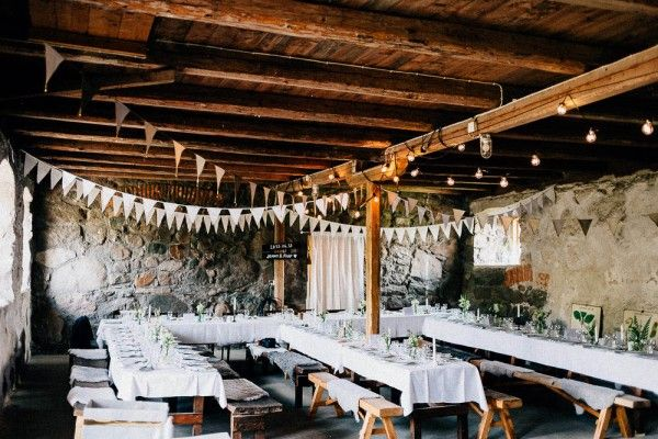 Stone walls, wood ceiling, pretty bunting | Photo by Jonas Karlsson