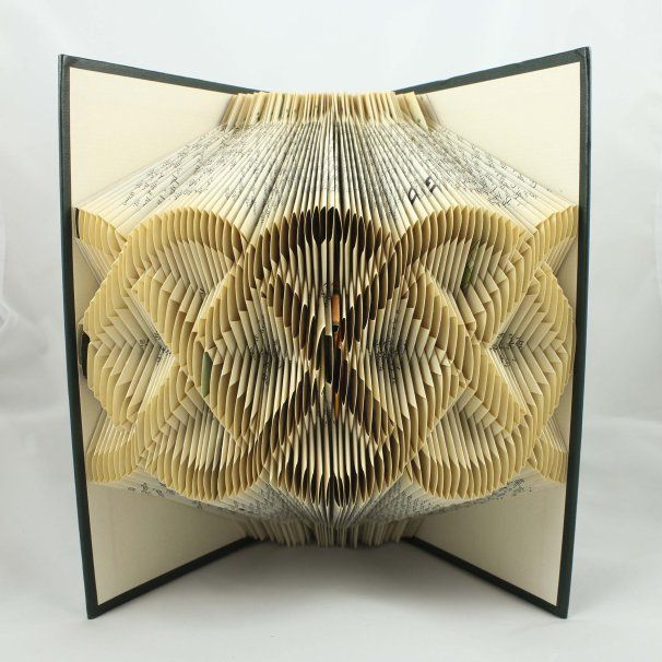 beautiful folded book art featuring words and patterns that pop out of pages - Book Pages Art